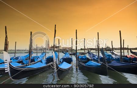 Parked gondolas in Venice, Italy stock photo, Many parked gondolas at the dusk in Venice, Italy by johnnychaos