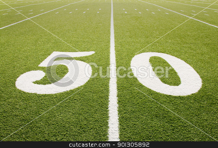 Fifty Yard Line stock photo, Closeup of 50 yard line on football field. by Danny Hooks