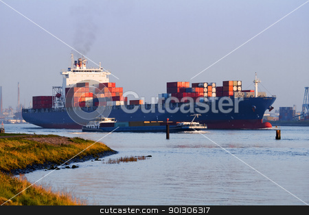 Big container ship on the river stock photo, Big container ship on the river leaving port by evening light by Colette Planken-Kooij
