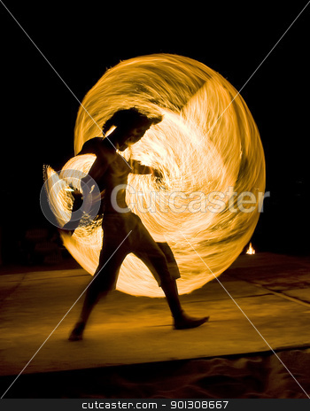 Man dancing with fire stock photo, Young man on fire performance. Motion blurred by johnnychaos