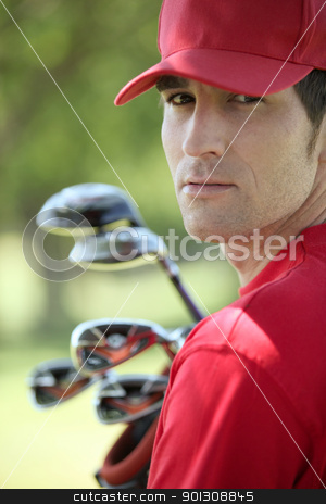 Golfer holding golf clubs. stock photo, Golfer holding golf clubs. by photography33