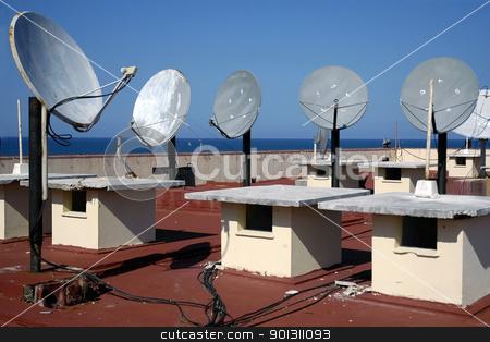 Satellite Dish stock photo, Group of satellite antennas on a root top by ruigsantos