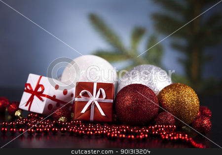 Red satin Christmas bauble  stock photo, Photography of baubles and gift connected with Christmas time and Christmas tree. by Sebastian Duda
