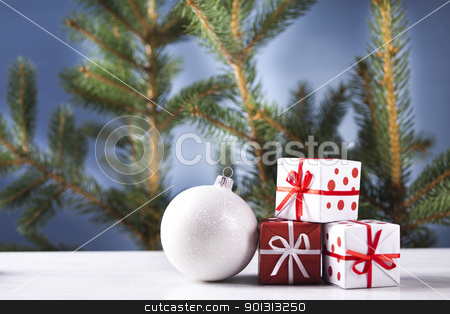 Cut spruce and Christmas ball stock photo, Photography of baubles and gift connected with Christmas time and Christmas tree. by Sebastian Duda