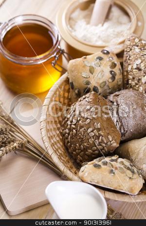 Assortment of baked bread  stock photo, Still-life assortment of breakfast. by Sebastian Duda