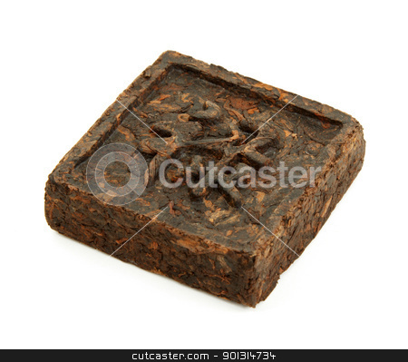 Pressed briquette of green tea with hieroglyphic on white backgr stock photo, Pressed briquette of green tea with hieroglyphic on white background by Ruslan Kudrin