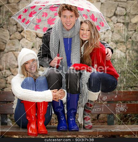 happy smiles in the rain with umbrella stock photo, happy smiles in the rain with umbrella by mandygodbehear