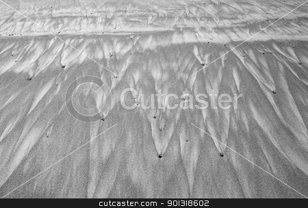 Sandscape stock photo, Sand designs left by retreating ocean waves by bobkeenan