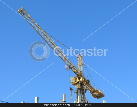 Tower crane in the city stock photo, Tower crane in the city by Stoyanov
