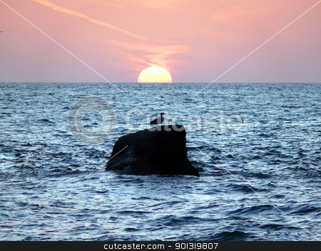 Sunset in the sea stock photo, Sunset in the sea by Stoyanov