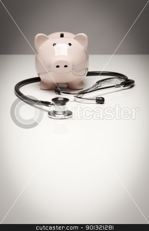 Piggy Bank and Stethoscope with Selective Focus stock photo, Piggy Bank and Stethoscope with Selective Focus on a Gradated Background. by Andy Dean