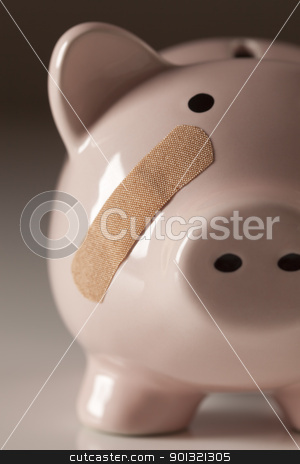 Piggy Bank with Bandage on Face stock photo, Piggy Bank with Bandage on Face on Gradated Background. by Andy Dean
