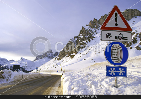 snowy street stock photo, snowy street in winter in the Italian Alps by freeteo