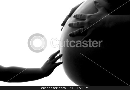 A Child's Reach to a Future Sibling stock photo, This photo is an attempt to capture the beauty and elegance of life.  A child's hand reaching out to a mothers pregnant belly while also being held by the Father. by Darcy Michaelchuk