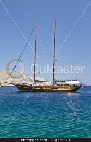Sailing boat  stock photo, Wooden sailing boat in Aegean Sea  by Sasas Design
