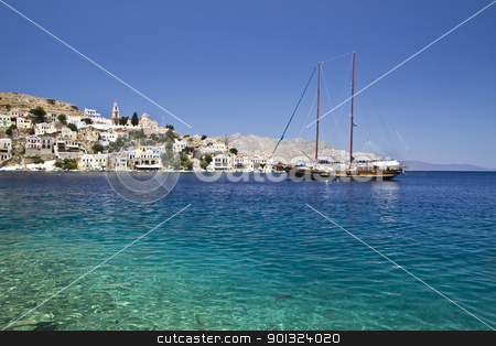 Colorful houses and sailing boat  stock photo, Colorful houses and sailing boat in Symi  island of Greece by Sasas Design