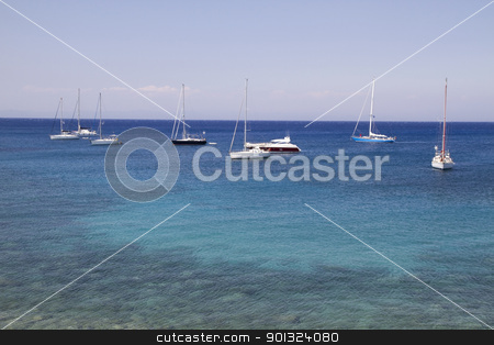 Sailing boats  stock photo, Many sailing boats on clam ocean and blue sky by Sasas Design