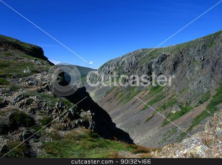 Mountain valley stock photo, Mountain valley with blue sky  by Sasas Design