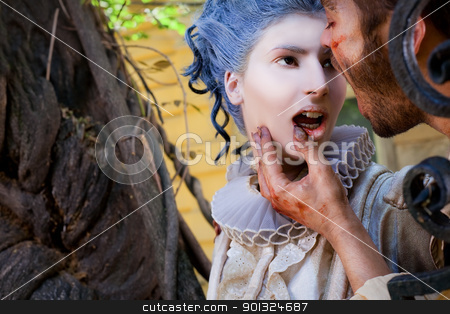 Male vampire touching ypung woman's lips stock photo, Close-up of wounded male vampire touching young medieval woman's bleeding lips by vilevi