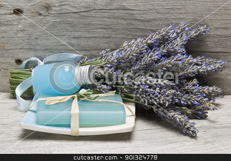 Lavender, and hygiene items. stock photo, Lavender and some hygiene items made of lavender on an old wooden shelf. by angelsimon