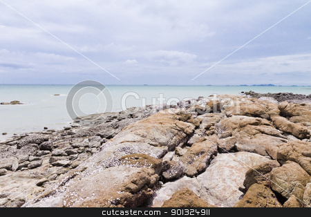 Rocky beach by the sea. stock photo, Beaches, rocky areas. The sea east of Thailand. by Na8011seeiN