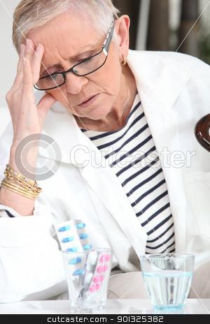 Senior woman taking drugs stock photo, Senior woman taking drugs by photography33