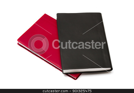 Red and black notebooks stock photo, Red and black notebooks isolated on white background by Sasas Design