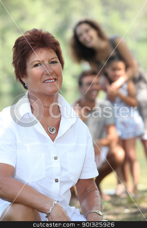 A grandmother enjoying a Sunday afternoon with her family. stock photo, A grandmother enjoying a Sunday afternoon with her family. by photography33