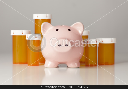 Piggy Bank In Front of Several Medicine Bottles stock photo, Piggy Bank In Front of Several Medicine Bottles on a Gradated Background. by Andy Dean