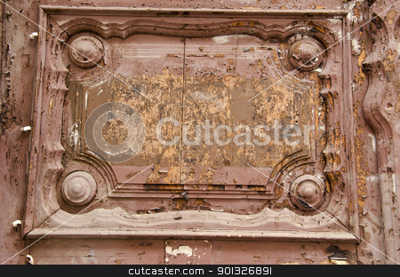 Ancient wooden door fragment. stock photo, Old wooden door fragment. Architectural ornaments and peeled paint. by sauletas