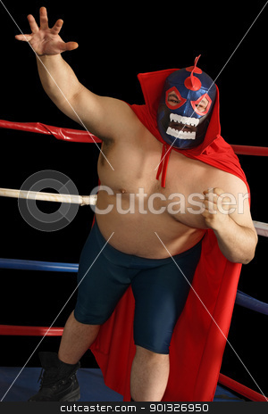 Mexican wrestler attacks stock photo, Photograph of a Mexican wrestler or Luchador standing in a wrestling ring. by © Ron Sumners