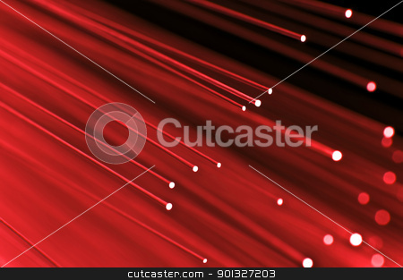 High speed technology concept stock photo, Close up on the ends of a selection of illuminated red fiber optic light strands with black background. by Samantha Craddock