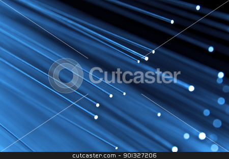 High speed technology concept stock photo, Close up on the ends of a selection of illuminated blue fiber optic light strands with black background. by Samantha Craddock