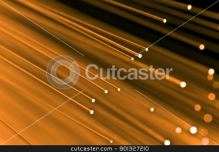 Golden technology concept stock photo, Close up on the ends of a selection of illuminated orange fiber optic light strands with black background. by Samantha Craddock