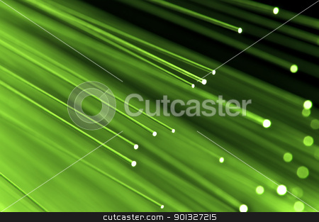 Fiber optical concept stock photo, Close up on the ends of a selection of illuminated light green fiber optic light strands with black background. by Samantha Craddock