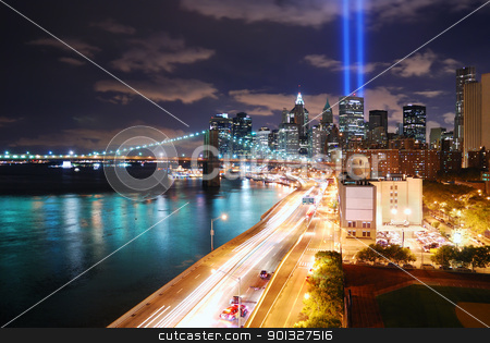 Manhattan at night stock photo, Remember September 11. New York City Manhattan panorama view at night with office building skyscrapers skyline illuminated over Hudson River and two light beam in memory of September 11. by rabbit75_cut