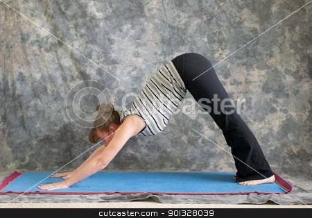 woman doing yoga posture adho mukha svanasana or downward