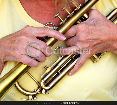 Female trumpet player. stock photo, Female trumpet player holding her instrument. by OSCAR Williams