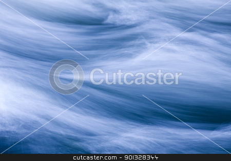 Rushing Water stock photo, Rushing water in a river, toned blue by Bryan Mullennix