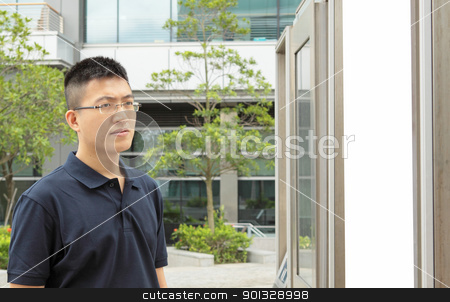 man seeing the advertising board stock photo, man seeing the advertising board at day by Keng po Leung