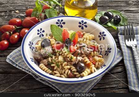 Italian Fusilli pasta with swordfish stock photo, Italian Fusilli pasta with swordfish,olive and raw tomato by maxg71