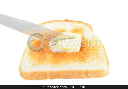 Buttered Toast stock photo, A slice of toast being buttered with a knife, isolated on white. by Richard Nelson