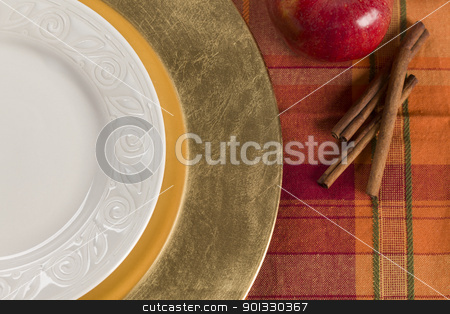 Abstract Table Setting of Apple and Cinnamon with Plate stock photo, Abstract Fall Colored Table Setting of Apple and Cinnamon with Empty Plate. by Andy Dean