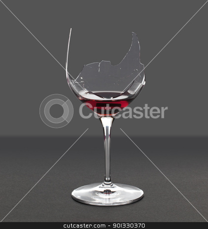 Demon drink red wine in glass stock photo, Red wine in a broken wine glass with an extraction path saved in the file by Steven Heap