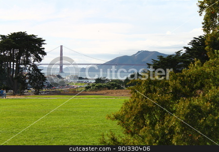 The green and the bridge stock photo, A shot of the Golden Gate bridge from the park by willeye
