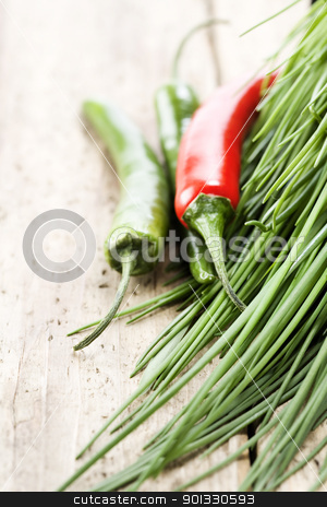 Fresh vegetables stock photo, chives and chili peppers on a wooden table top by klenova