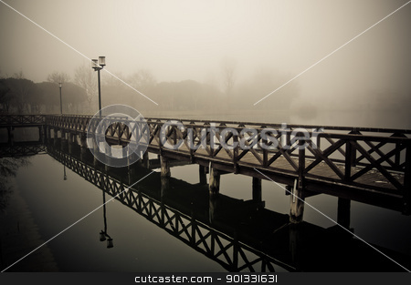 Foggy Winter Docks stock photo, Located in Bellaria Igea Marina, Italy. Near the Adriatic Sea. A winter photo showing fishing docks in a foggy morning by dirimir