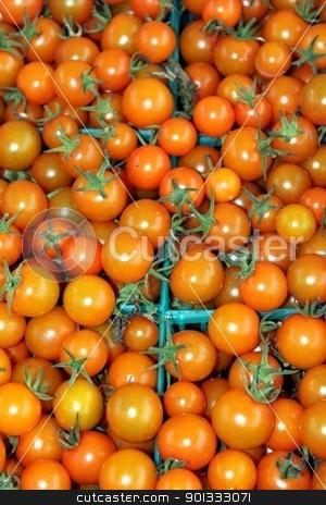 Orange Cherry Tomatoes stock photo, Orange cherry tomatoes at a farmers market in baskets by Henrik Lehnerer