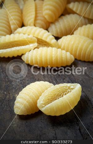 Italian raw pasta stock photo, close up of Italian raw pasta on wood by maxg71