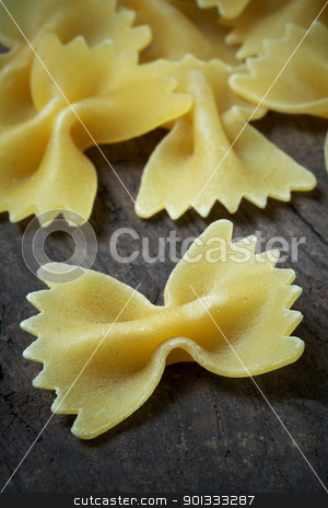 Italian raw pasta stock photo, close up of Italian raw pasta on wood by maxg71